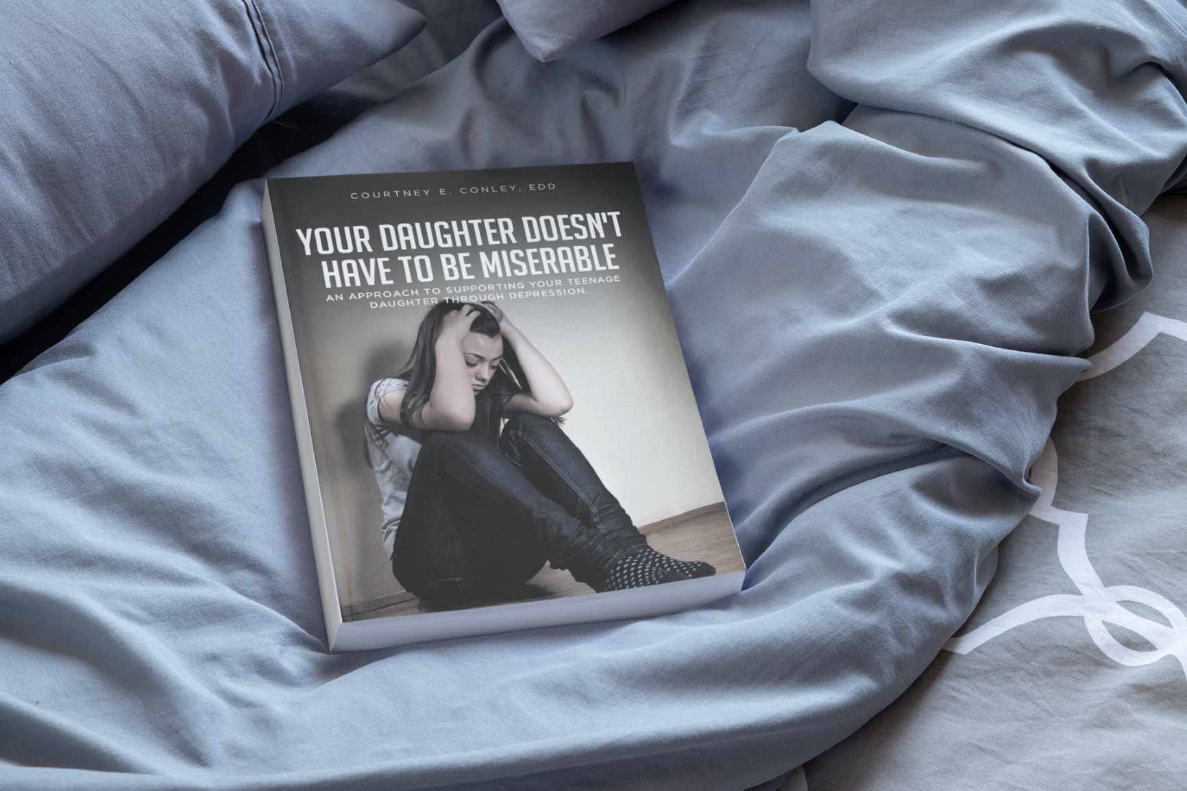 mockup-featuring-a-paperback-book-placed-on-a-cozy-bed_Resized